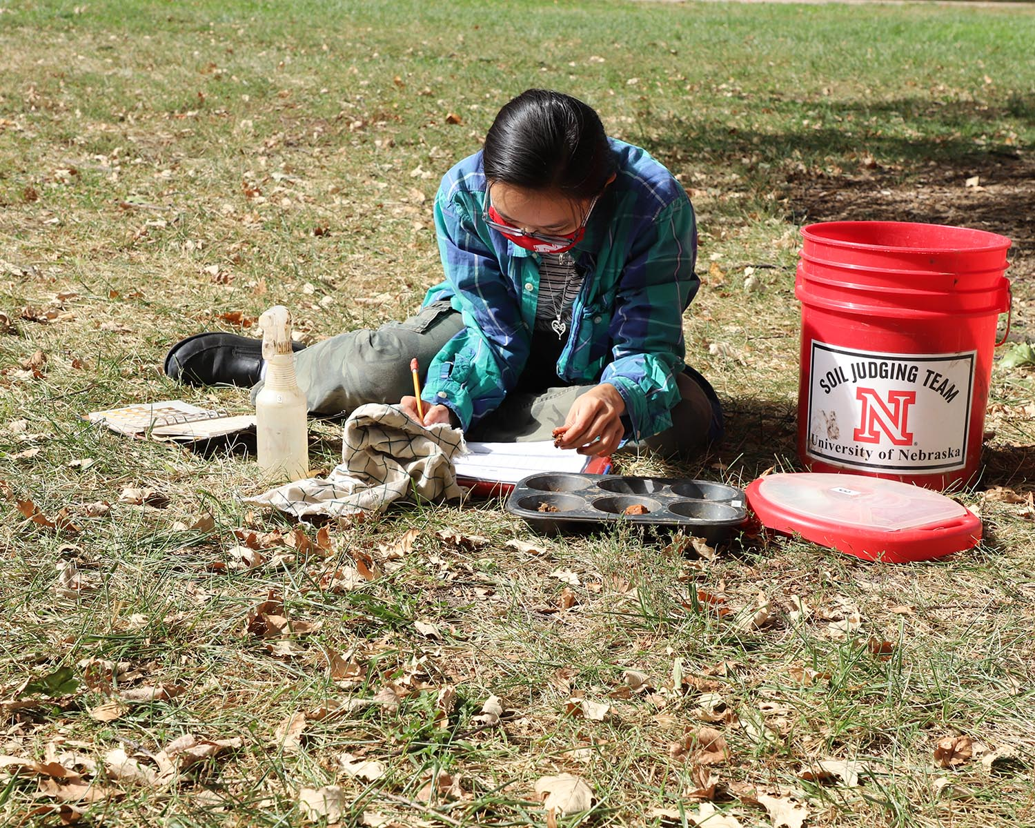 Phuong Minh Tu Le makes notes about her soil texture and soil color determinations during an Oct. 2 practice session in advance of the Region 5 Soil Judging Competition. The competition is being held virtually this year. Lana Koepke Johnson, UNL Agronomy
