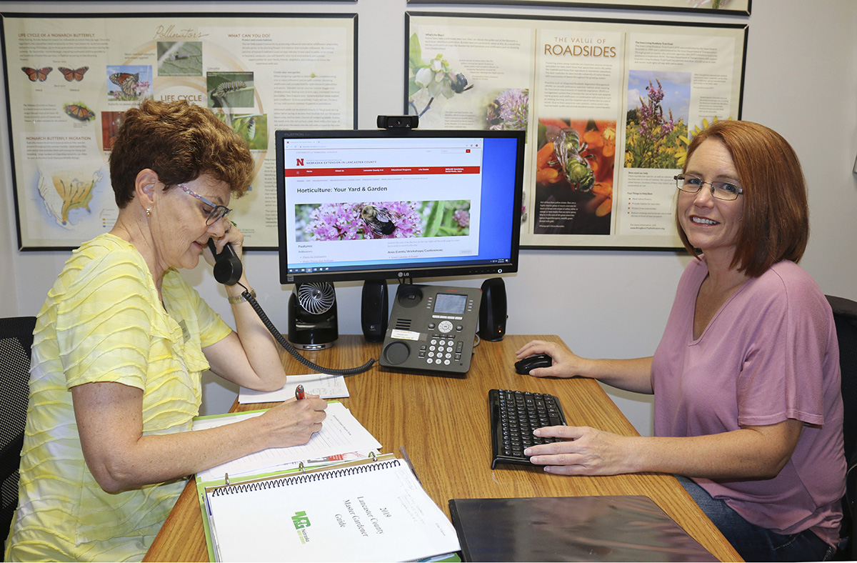 Master Gardeners volunteering answering phones.
