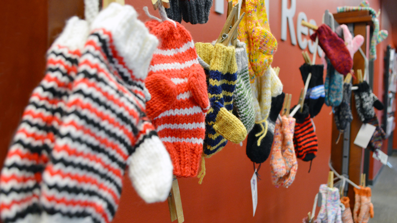 The School of Natural Resources annual Caring for Clinton donation drive provides toiletries and winter gear, like Anne Mulligan's hand-knitted mittens, to Clinton Elementary School students and their families. Drop off your donations in Hardin Hall.