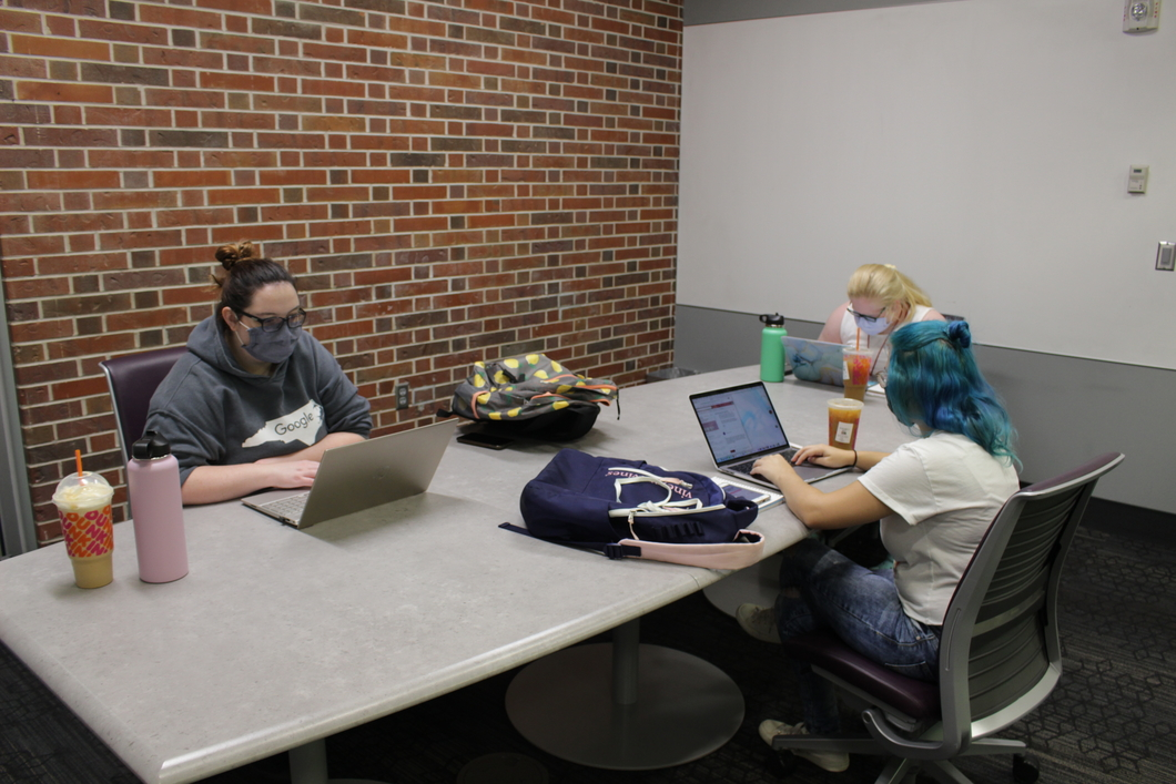 Students studying and working in the Adele Hall Learning  Commons