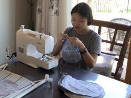4-H youth sewing surgical hats