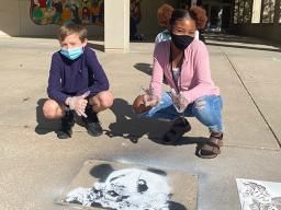 """Students at Park Middle School in Lincoln created spray chalk animals from stencils as part of the """"Stay Wild"""" community arts project."""