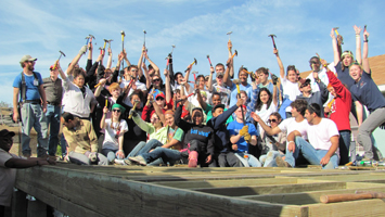 Students pose for a photo during a previous service learning trip.