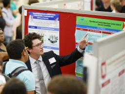 Student presenting research at the Nebraska Summer Research Symposium