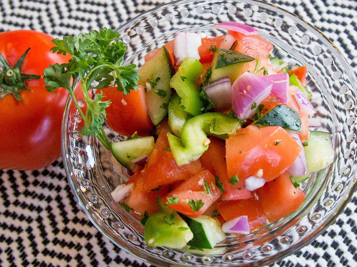 Photo of tomato cucumber salad in a bowl