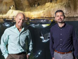 Jay Storz (left), Willa Cather Professor of biological sciences, and postdoctoral researcher Anthony Signore with penguins at Omaha's Henry Doorly Zoo and Aquarium. Craig Chandler | University Communication