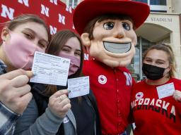 Students pose with Herbie Husker after getting vaccinated in a Pfizer clinic on April 20.