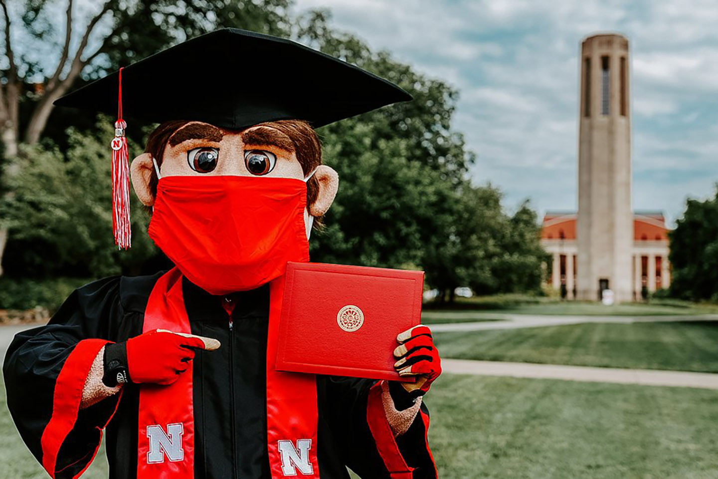 Mascot Herbie Husker with his diploma.