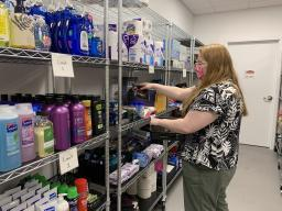 Graduate assistant Katie Peterson restocks the product shelves on the first day that in-person visits resumed at Husker Pantry. May 12, 2021. [Christopher Dulak   Student Affairs]