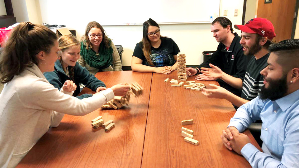 CRE students number the blocks in the game Jenga and play it with special rules to teach resilience concepts. Pictured are (from left) Julie Fowler, Jessica Johnson, Alison Ludwig, Rubi Quiñones, Conor Barnes, Dominic Cristiano and Daniel Morales.