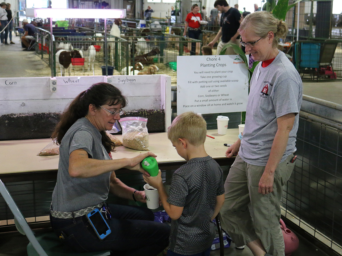 One of the hands-on activities at the Fun on the Farm Kid Zone at the Super Fair is planting crop seeds to take home.