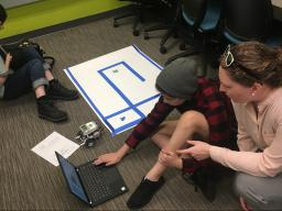Brittany Duncan helps a student code at the Girls Inc. Eureka! coding camp in July.