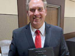 Associate Professor of Voice and Vocal Pedagogy and Director of Faculty Development for the Office of the Executive Vice Chancellor's Faculty Affairs team Kevin Hanrahan received the James A. Lake Academic Freedom Award at the Faculty Senate meeting in Se