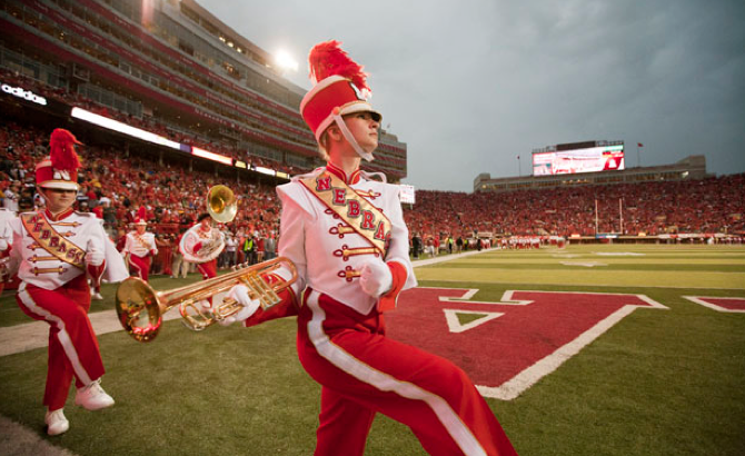 Members of the Cornhusker Marching Band take the field during the 2011 homecoming game with Ohio State. Photo by Craig Chandler, University Communications