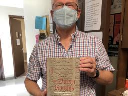 """Professor of Music History Peter Lefferts with his new book, """"The Dorset Rotulus: Contextualizing and Reconstructing the Early English Motet,"""" published by Boydell Press in London."""