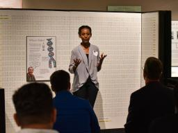 Students present three-minute quick pitches on new business ventures to a panel of judges.