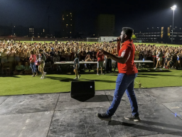 Event host D-Wayne pumps up the crowd as Showtime at Vine Street fields begins.