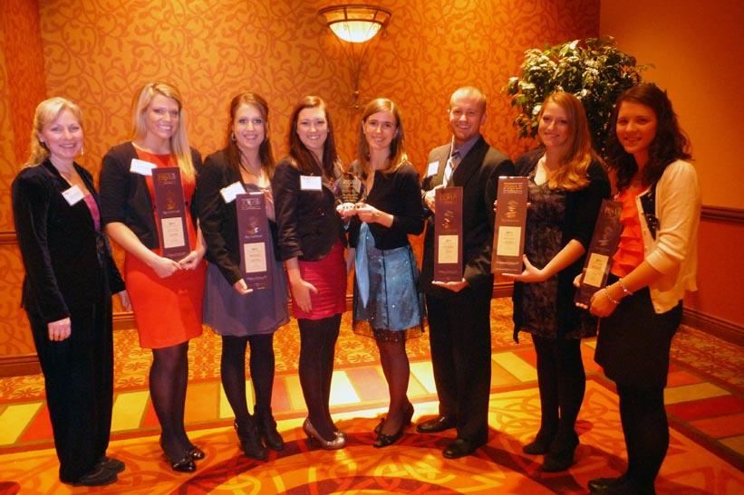 UNL PRSSA adviser Phyllis Larsen and PRSSA members attended the PRSA Nebraska gala on Dec. 8.  Larsen, left, is joined by  Brooke Herbig,  Sydnie Burton,  Molly Zerener,  Marie Zborilová,  Matt Hunnel,  Angela Wickard,  Jessica Jensen.