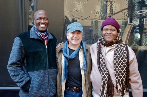 Ladysmith Black Mambazo performers Albert Mazibuko (left) and Joseph Shabalala (right) with Paul Simon.