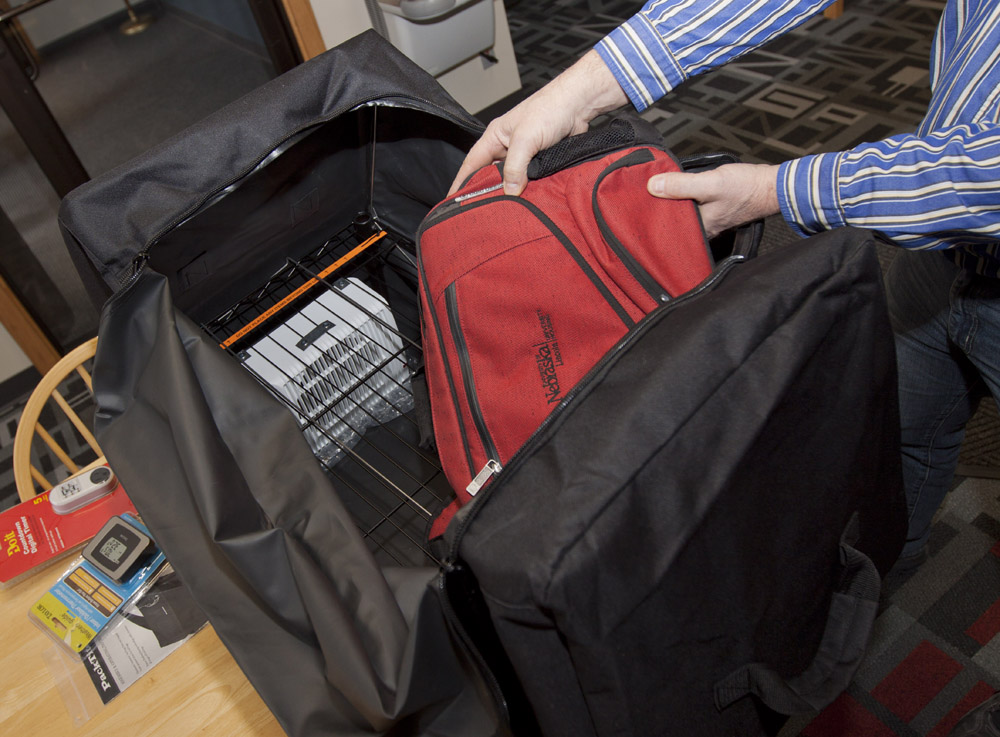 University officials demonstrate how heat treatment bags work. The bags are designed to eliminate bedbugs on small items, like book bags.