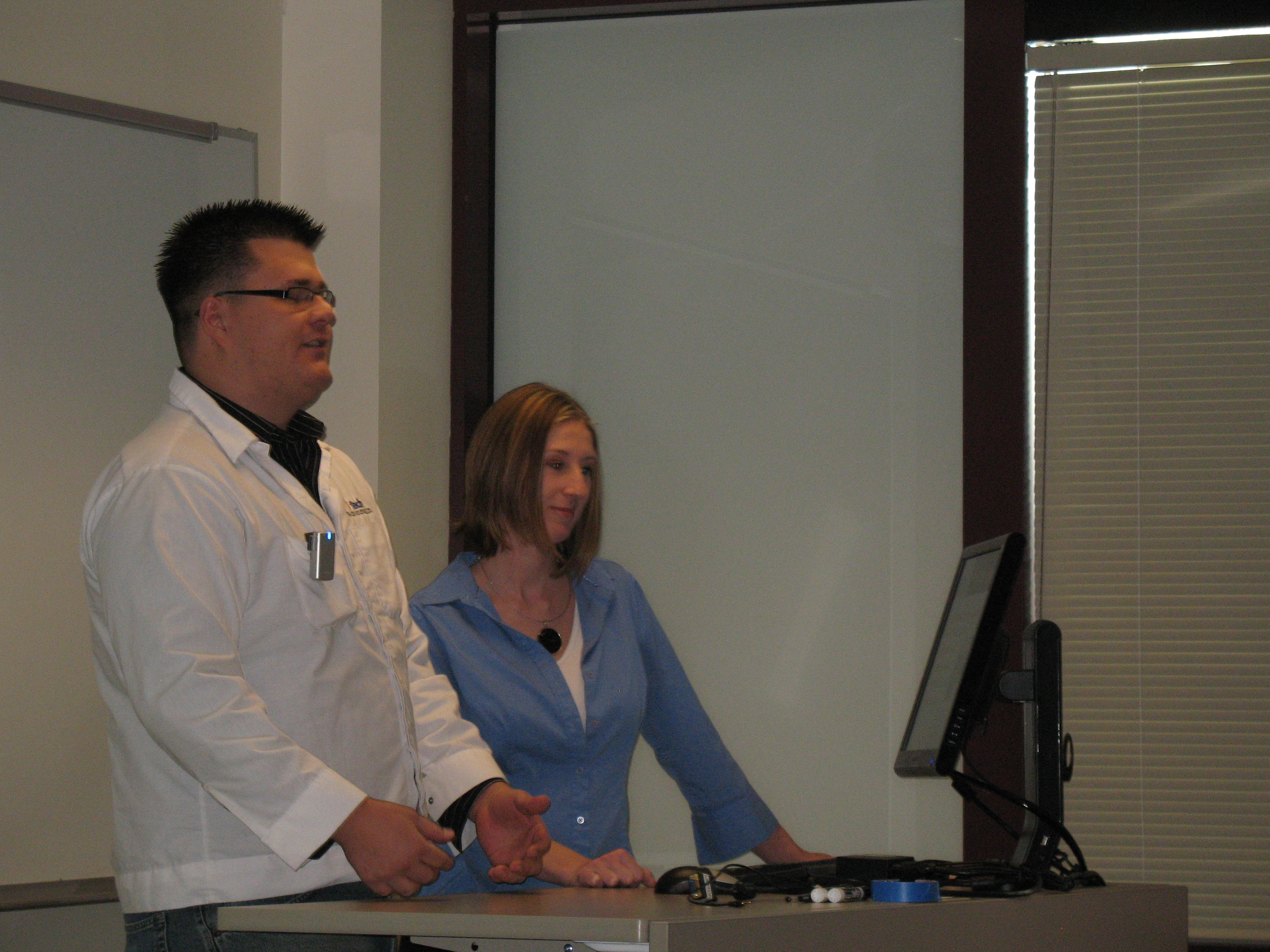 Lee Paulson, left, and Wendy Lowery, both from Tri-Con, explain their research needs to Environmental Studies students.