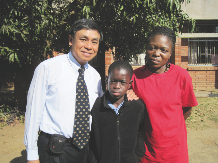 UNL's Charles Wood and two of patients in Zambia,  Jailos Zulu (left) and Tina Kaaya. The mother/son duo have been patients at Wood's Zambia clinic since Jailos was born.