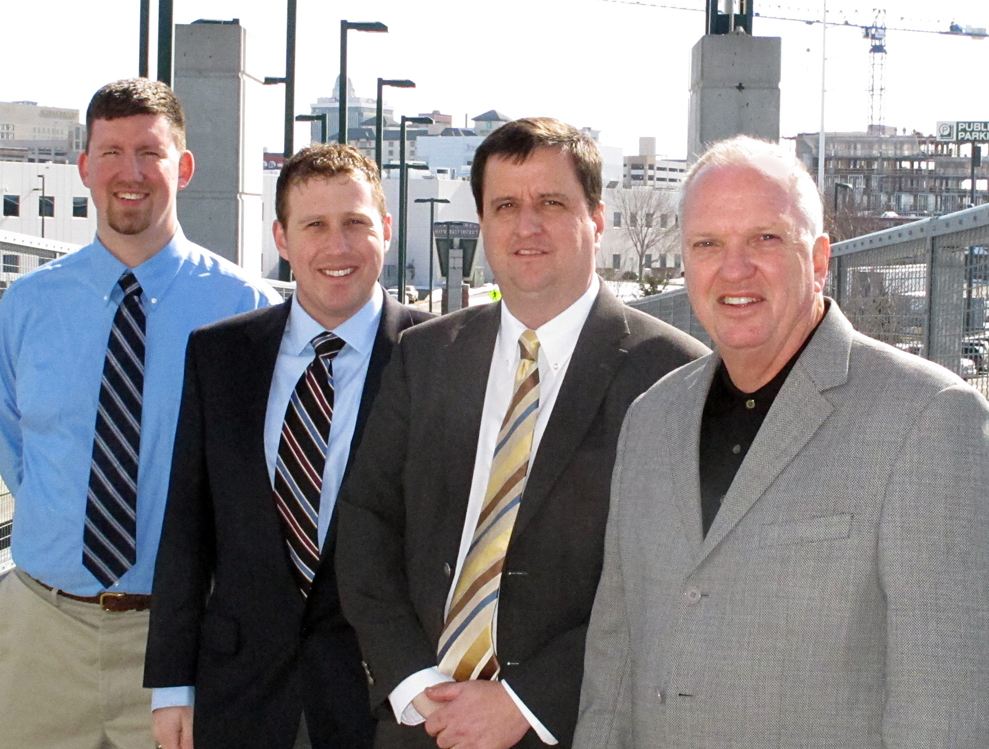 Adam George (left), Eric Ransom, Eric Thompson and William Walstad helped develop the first Leading Economic Indicator report for Nebraska, released today.