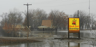 Dark marks on signs and buildings show how high Missouri River floodwaters got last summer near Rock Port, Mo. Photo by Steve Ress.