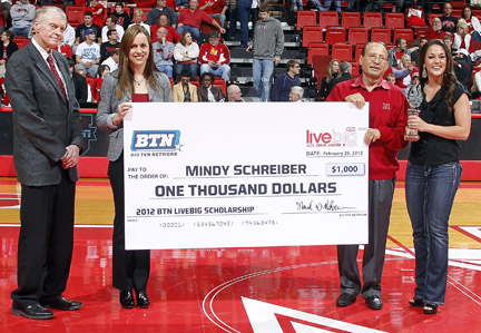 Mindy Schreiber (far right) is presented with the Big Ten Network's LiveBIG scholarship on Feb. 29.