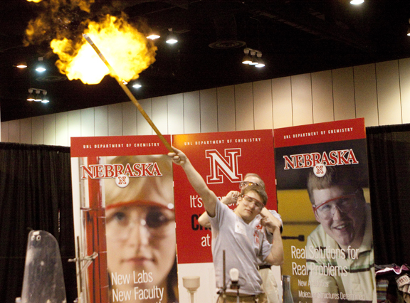 A gas-filled ballon ignites with a boom during the hourly chemistry demonstration during the 2010 Big Red Road Show at Omaha Qwest Center. Photo by Craig Chandler / University Communications