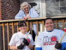 Student volunteers pose with a Lincoln resident during UNL's 2011 Big Event.