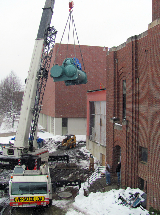 A new chiller unit is moved into place in the City Campus utility plant in early February.