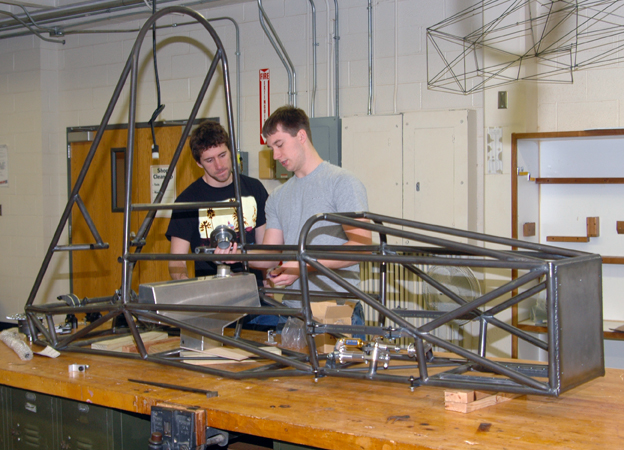 Mechanical engineering majors (from left) Griffin Hovorka and Anthony Hansen discuss the fuel tank positioning in Husker Motorsports' Formula SAE entry. UNL will host a national Formula SAE competition, June 20-23.