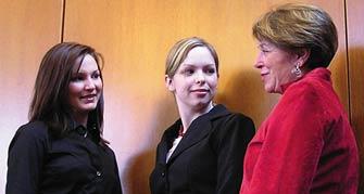 Students speak with an alumni member