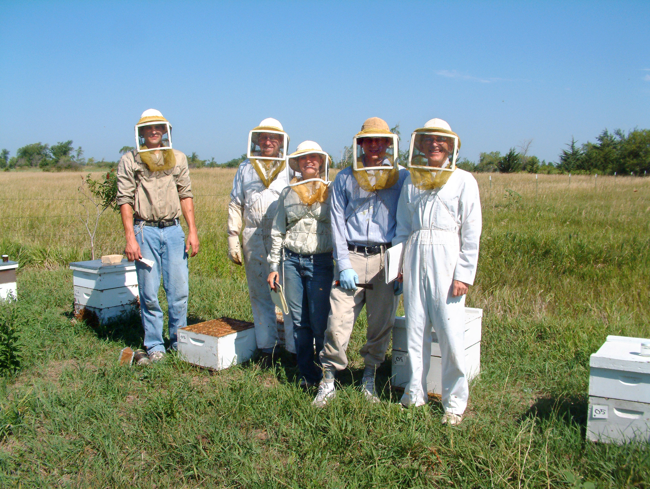 "The ""Bee Team"" from the UNL Department of Entomology takes a break from measuring square inches of brood.  From left: Jeremy Wagnitz, Bill McCormick, Sarah Mack, Nick Aliano and Bob Roselle."