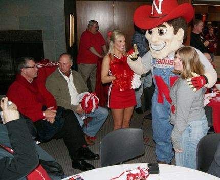 A Husker fan gets her photo taken with Herbie Husker during the 2011 Big Red Weekend.