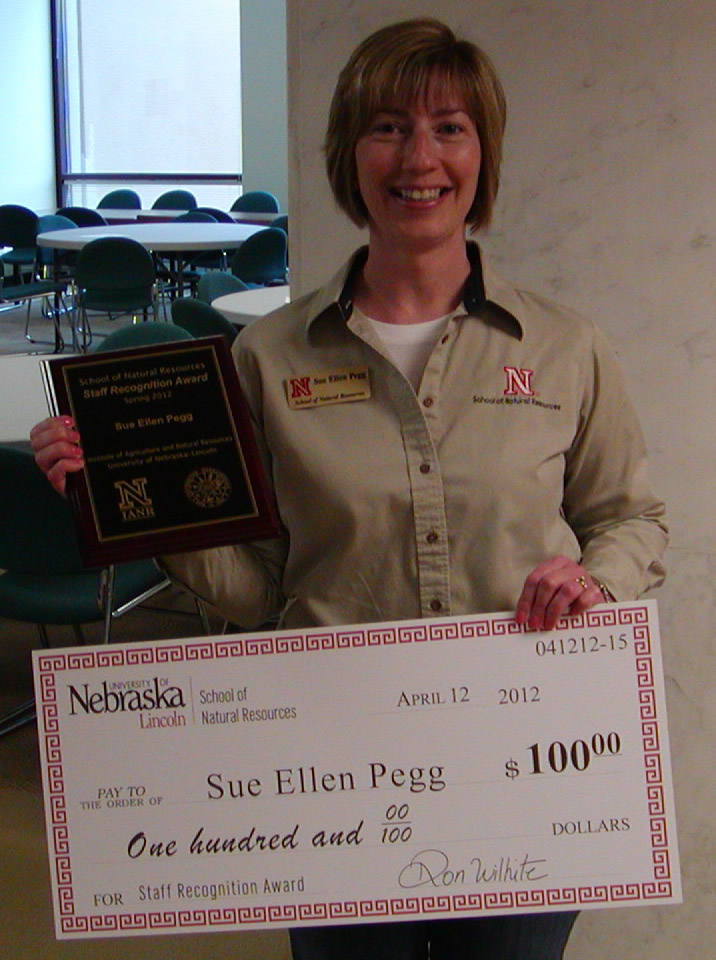 Sue Ellen Pegg received a plaque and a check in recognition of her outstanding performance.