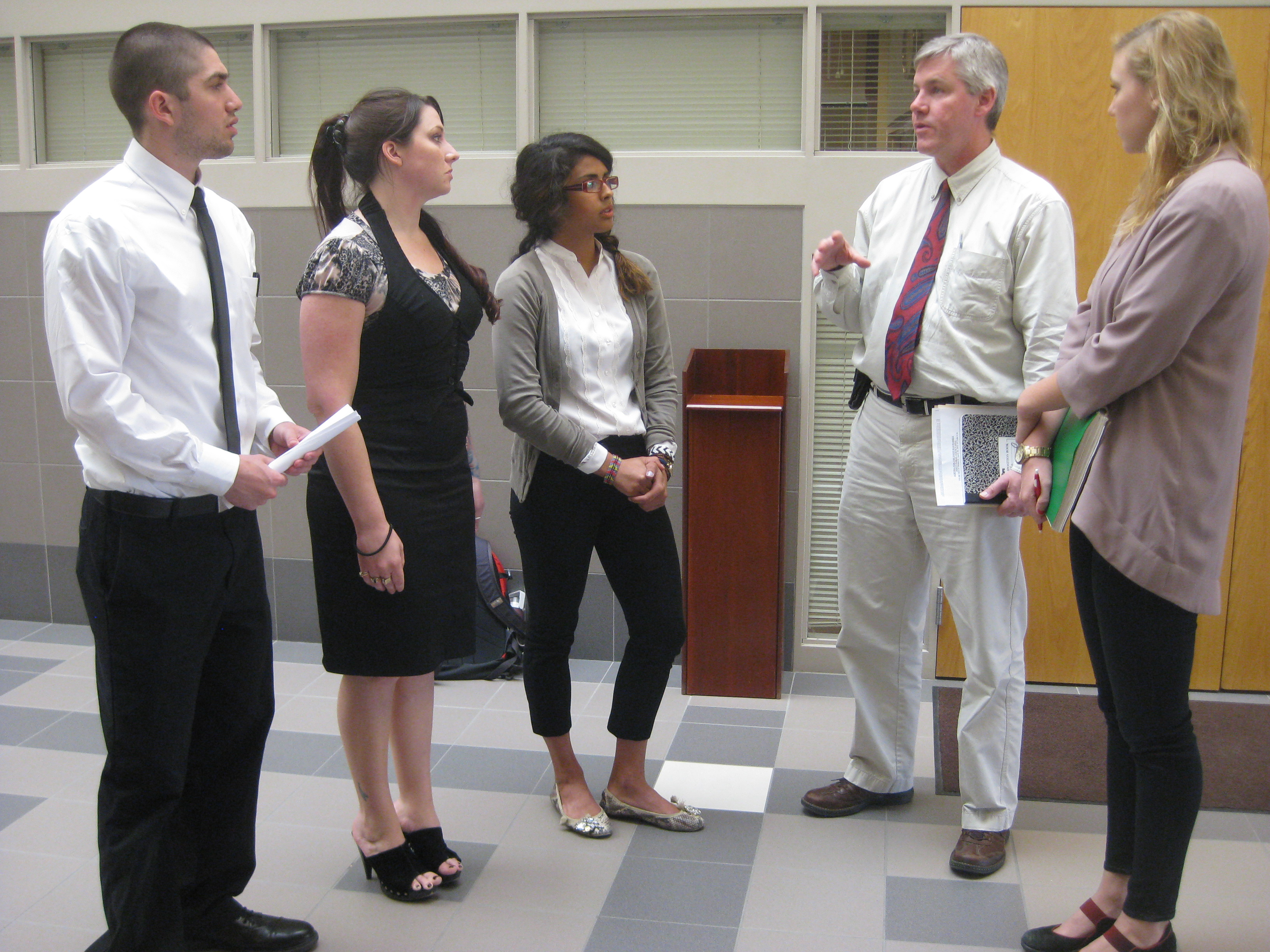 From left, students Tom Batter, Jesy Hansen and Kiana Mathew discussed sustainability with Milo Mumgaard and Emily McKeone from the mayor's office.