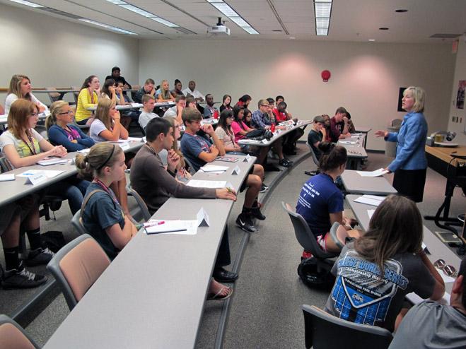 CBA Dean Donde Plowman talks to high school seniors in the Dream Big Academy last week.