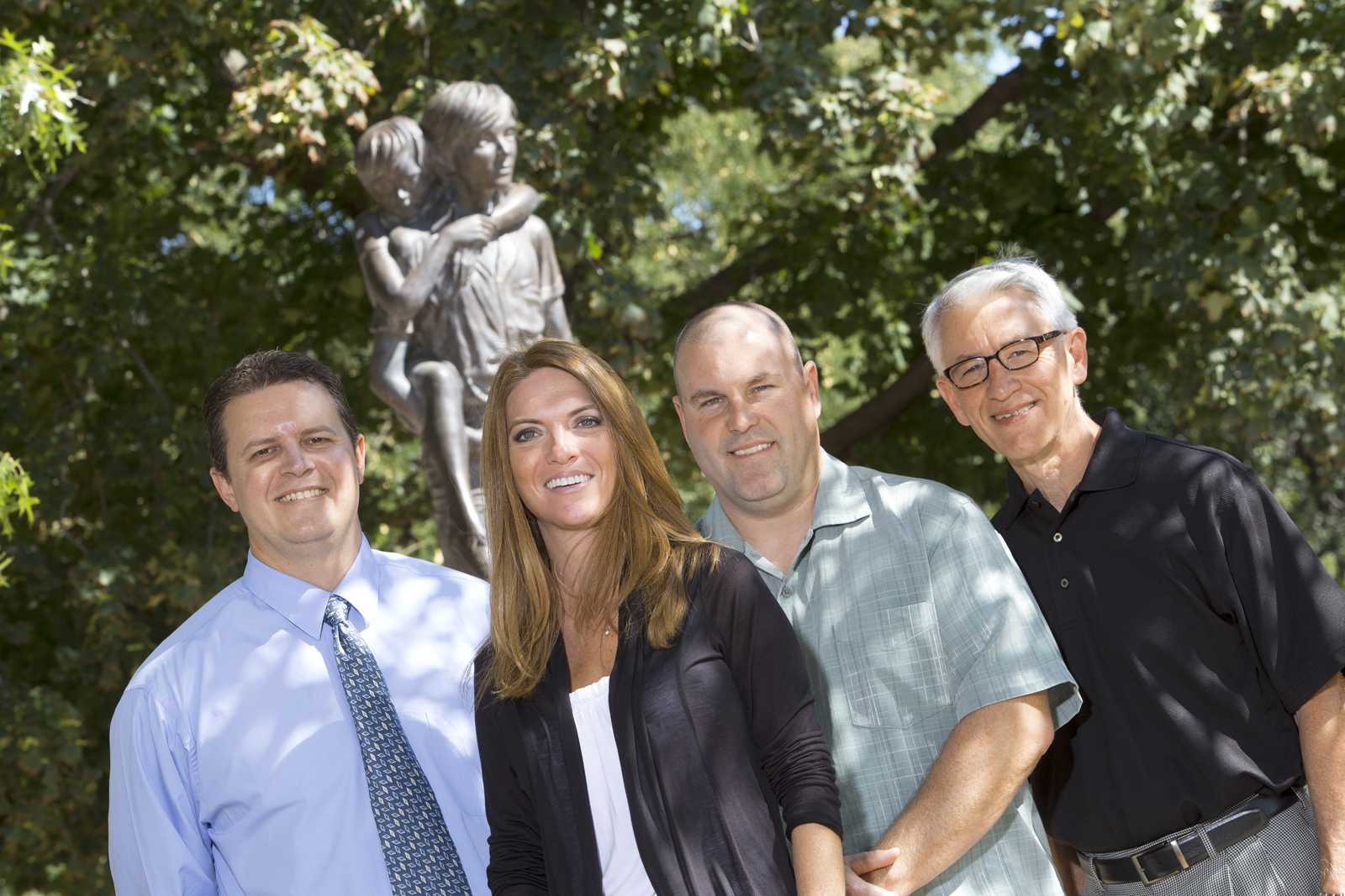 UNL's Alexandra Trout pictured on the Boys Town campus with Boys Town researchers (from left) Patrick Tyler, McLain Stewart and Ronald Thompson.
