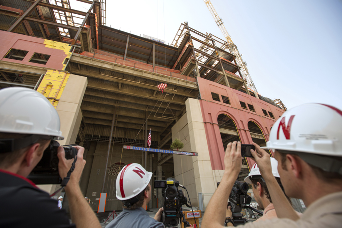 "As part of a steel-workers' tradition, the final beam was erected Aug. 30 in a ""Topping Off"" ceremony, attended by media."