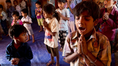 Muskan Salim and his classmates sing as a part of their limited curriculum in a slum school in Nangloi, a northwestern district of New Delhi, India on May 11. (Photo by Morgan Spiehs)