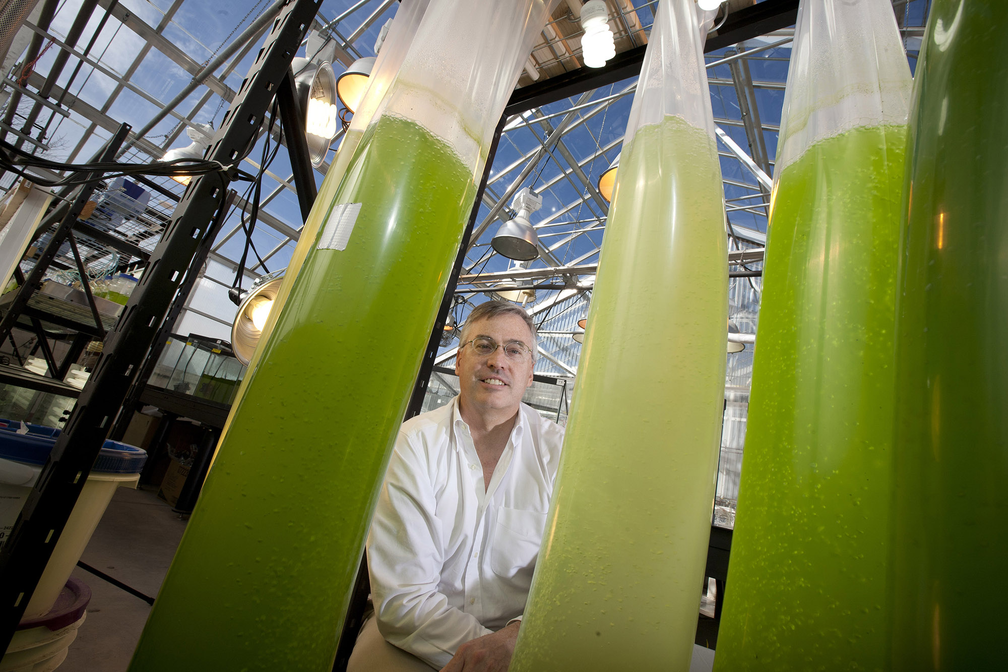 George Oyler, a University of Nebraska-Lincoln researcher and associate professor of biochemistry, said he believes that as more research is applied, advanced biofuels will continue to develop -- and at a faster pace. Oyler checks the algae bags in the al