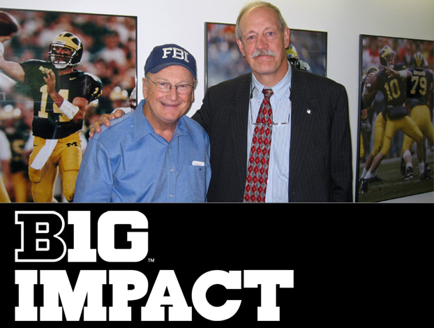 UNL Law grad and retired senior FBI agent Greg Stejskal (right) poses with former Michigan coach Bo Schembechler.
