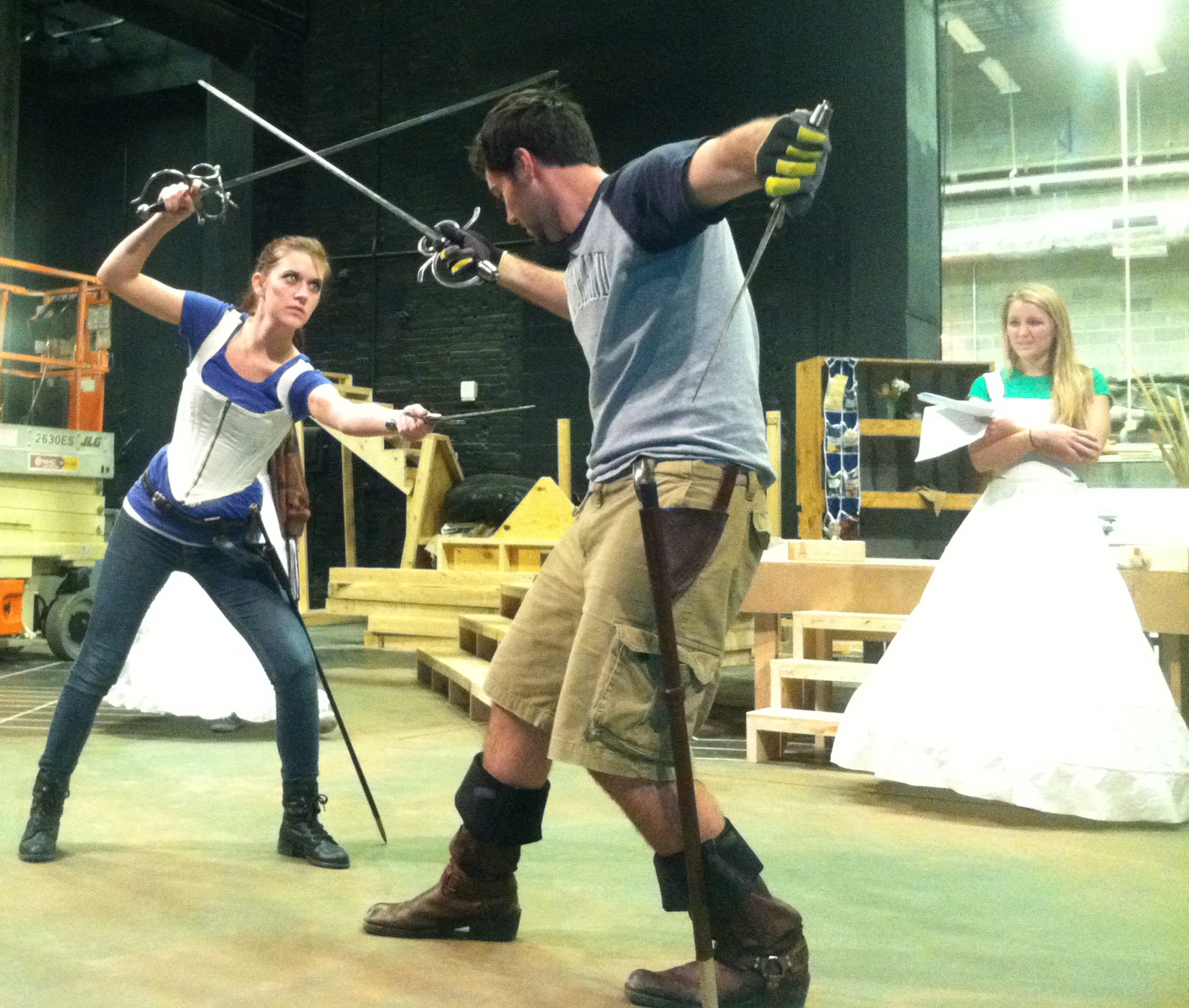 "Kayla Klammer (left) and David Michael Fox (center) rehearse a fight scene for ""Agravio"" as Lucy Myrtue (right) observes."
