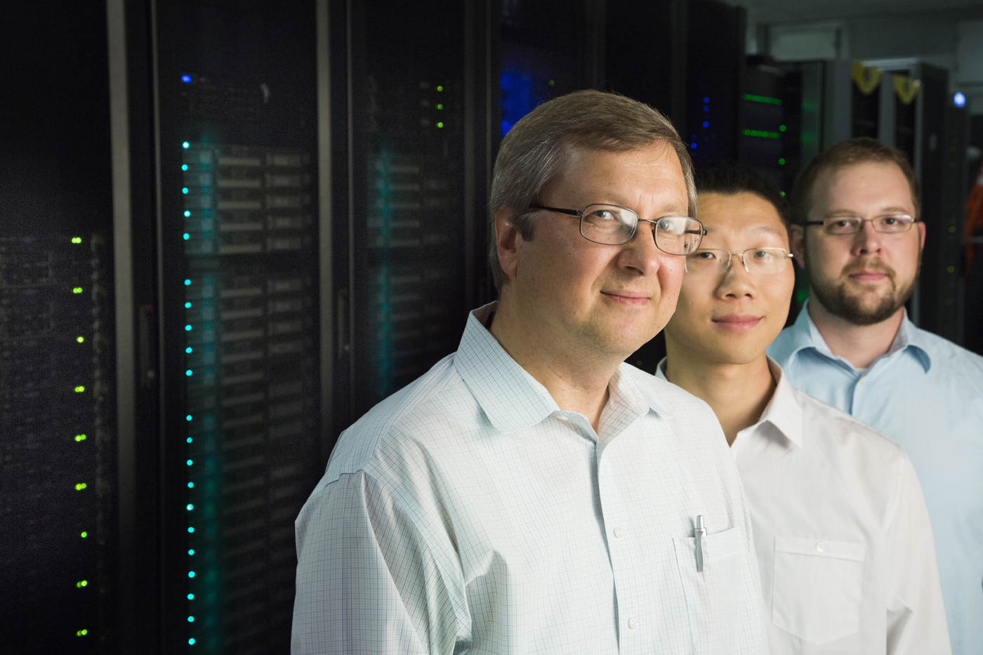 The UNL research team involved in the discovery includes (left) Evgeny Tsymbal, Yong Wang (now at the Pacific Northwest National Laboratory in Richland, Wash.) and J.D. Burton. In the background is a portion of the Holland Computing Center supercomputer.