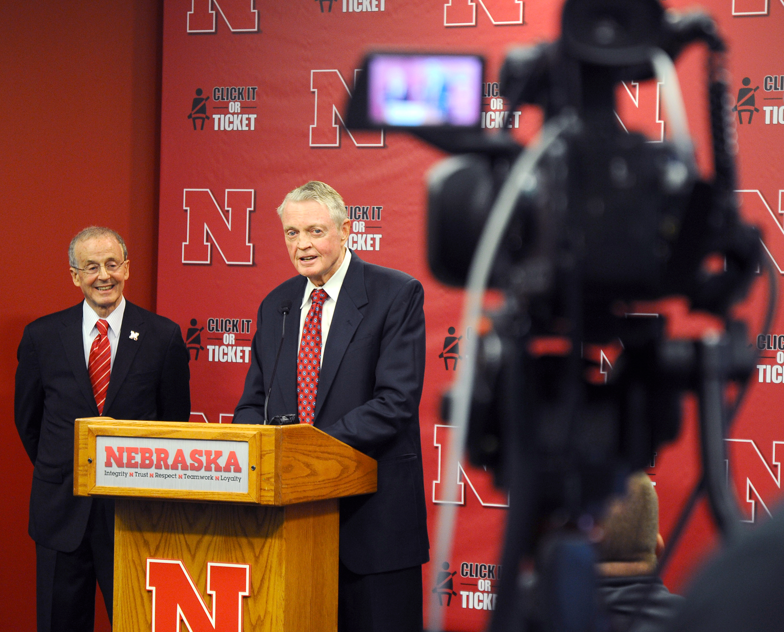 Chancellor Harvey Perlman and Activities Director Tom Osborne share a laugh during the Sept. 26 announcement at Memorial Stadium.