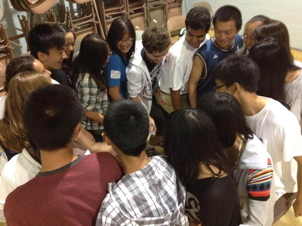 Students working as a team at the International Leadership Retreat