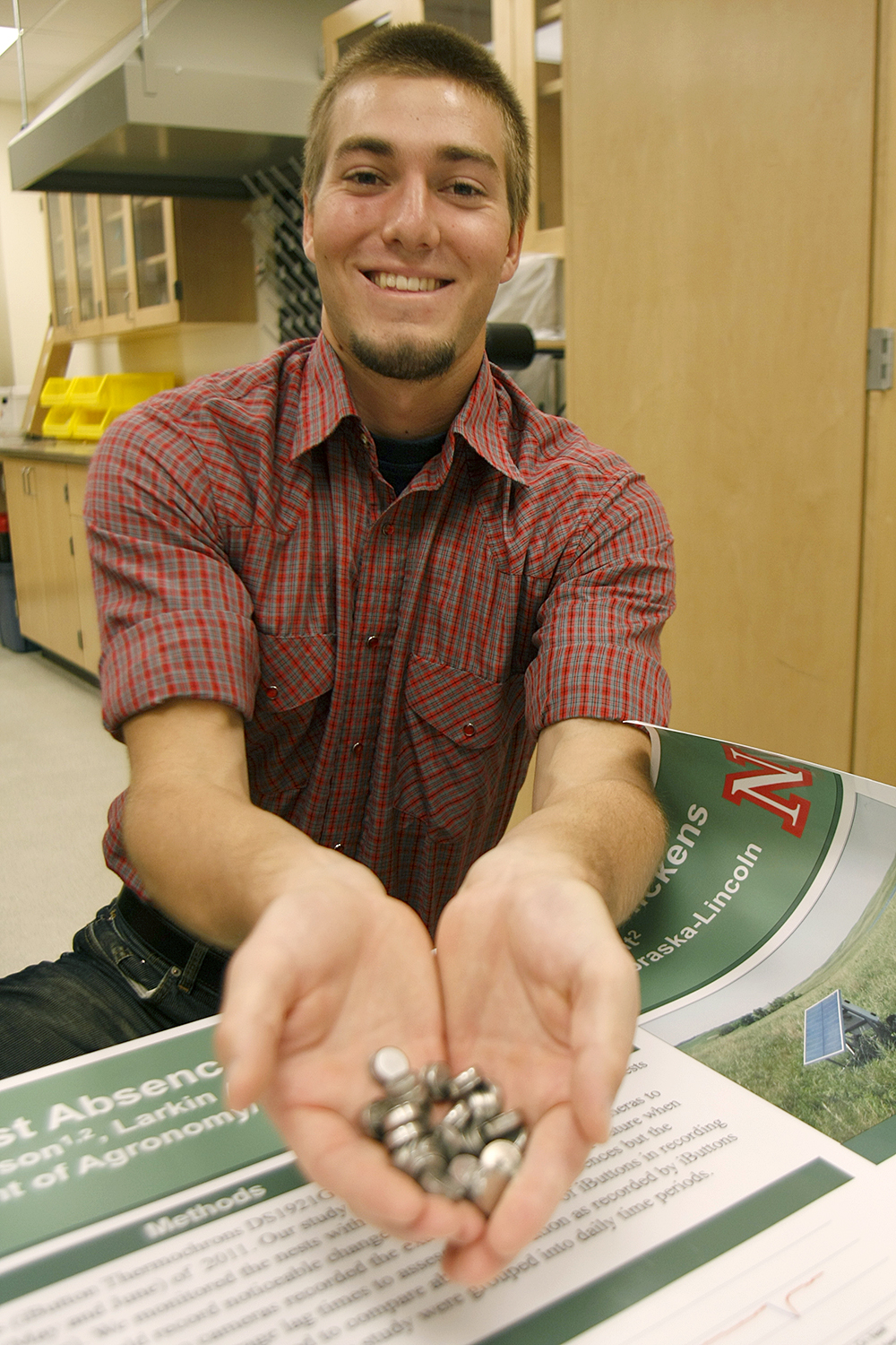 Josiah Dallmann, 20, won the Life Sciences poster competition recently for his work with small temperature sensors, or iButtons, that helped him track the nesting habits of prairie chickens in the Nebraska Sandhills.