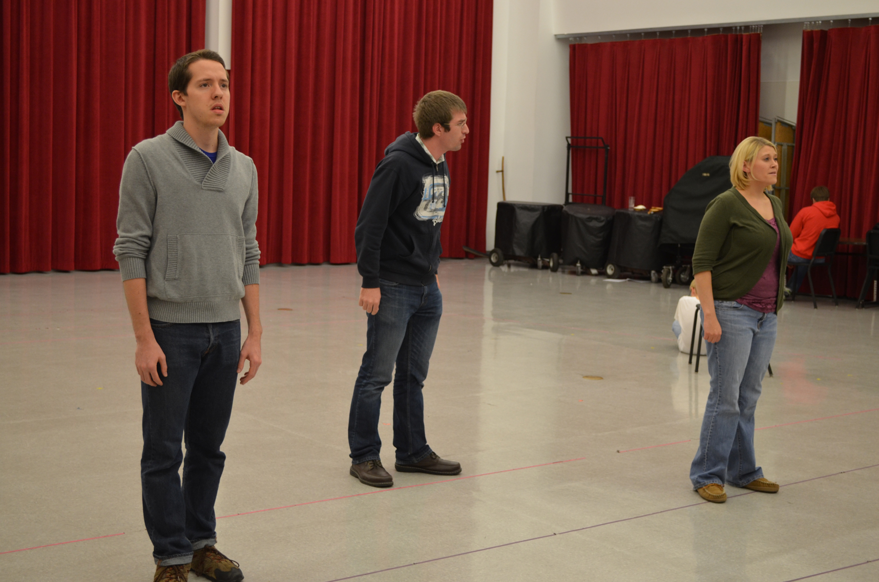 "(From left) Timothy Patrick Madden, Matthew Clegg and Talea Bloch rehearse an ""O Pioneers!"" opera scene."